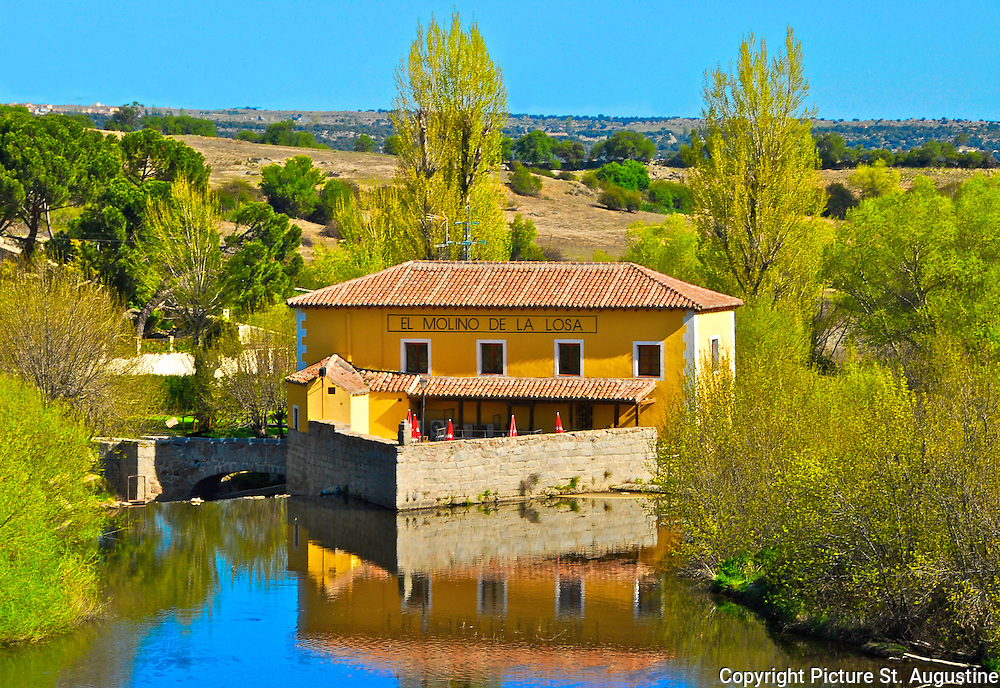 Landscape of lake, restuarant and hillsides surrounding Avila, Spain.