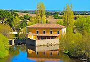 Landscape of lake, restuarant and hillsides surrounding Avila, Spain.
