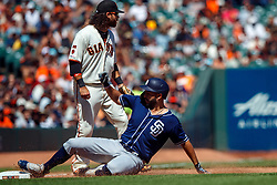 SAN FRANCISCO, CA - SEPTEMBER 01: Eric Hosmer #30 of the San Diego Padres slides into third base for a triple in front of Brandon Crawford #35 of the San Francisco Giants during the sixth inning at Oracle Park on September 1, 2019 in San Francisco, California. The San Diego Padres defeated the San Francisco Giants 8-4. (Photo by Jason O. Watson/Getty Images) *** Local Caption *** Eric Hosmer; Brandon Crawford