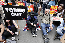© Licensed to London News Pictures. 01/07/2017. London, UK. The People's Assembly anti-austerity demonstration heads towards Parliament. Speakers include Labour Party Leader Jeremy Corbyn. Photo credit: Peter Macdiarmid/LNP