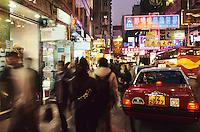 Neon signs and traffic, Tsim Sha Shui, Hong Kong