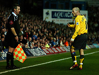 Photo: Ed Godden.<br /> Portsmouth v Arsenal. The Barclays Premiership. 12/04/2006. Fredrik Ljunberg argues with the linesman.
