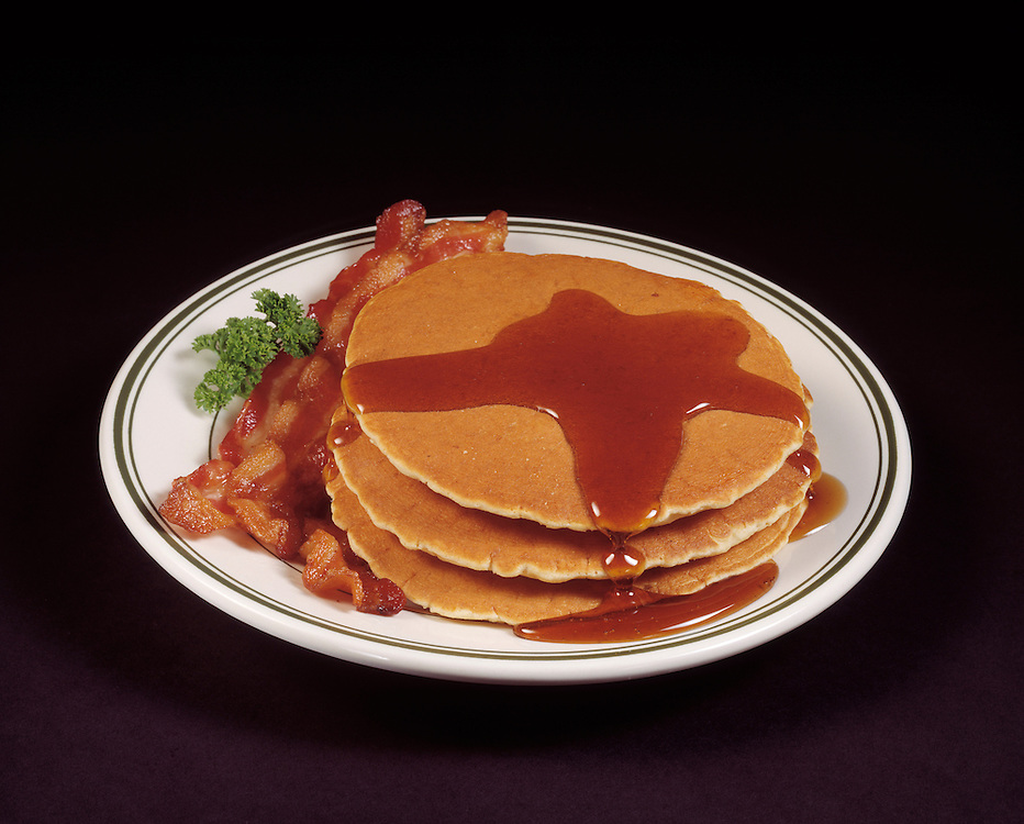 fast food hearty breakfast stack of pancakes bacon strips slices syrup white plate black background traditional american breakfast concept conceptual metaphor cuisine lifestyle travel Dine Entertaining Entice Enticing Fed Feed Feeding Flavor Flavorful Foodshot Fragrant Haute Gourmet Gourmand Good Gratify Gratifying Grocery Healthfood Hospitable Hospitality Ingredient Lunch Market Munchy Marketplace Natural Organic Portion Pretty Produce Refresh Refreshing Satisfying Satisfaction Seasonal Serve Serving Smell Still life