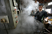 A worker takes newly-molded bath ducks out of the oven, in a factory in Fengxiang, near Shanghai, China, on October 30, 2008. Although Chinese authorities predict that 2009 will be a tough year, they are ready to do all that is takes to keep China's growth ''around 8%''. Beijing government announced a 450 billion euros investment plan until 2010 to boost Chinese economoy. ''We could take new measures (...) to prevent any economical downturn'' said Premier Wen Jiabao in Davos 2009 economy forum. Photo by Lucas Schifres/Pictobank