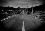 Twilight on a lonely highway through the ruins in the tsunami zone of Otsuchi, Iwate Prefecture, Japan.