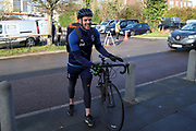 AFC Wimbledon fitness coach Jason Moriarty arriving for the game on a bike during the EFL Sky Bet League 1 match between AFC Wimbledon and Doncaster Rovers at the Cherry Red Records Stadium, Kingston, England on 14 December 2019.