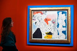 © Licensed to London News Pictures. 29/01/2020. LONDON, UK. A staff member views ''Groupe De Personnages'' by Joan Miró, (Est. £3,000,000 - 5,000,000).  Preview of Sotheby's Impressionist & Modern and Surrealist Art sales.  The auction will take place at Sotheby's New Bond Street on 4 and 5 February 2020.  Photo credit: Stephen Chung/LNP