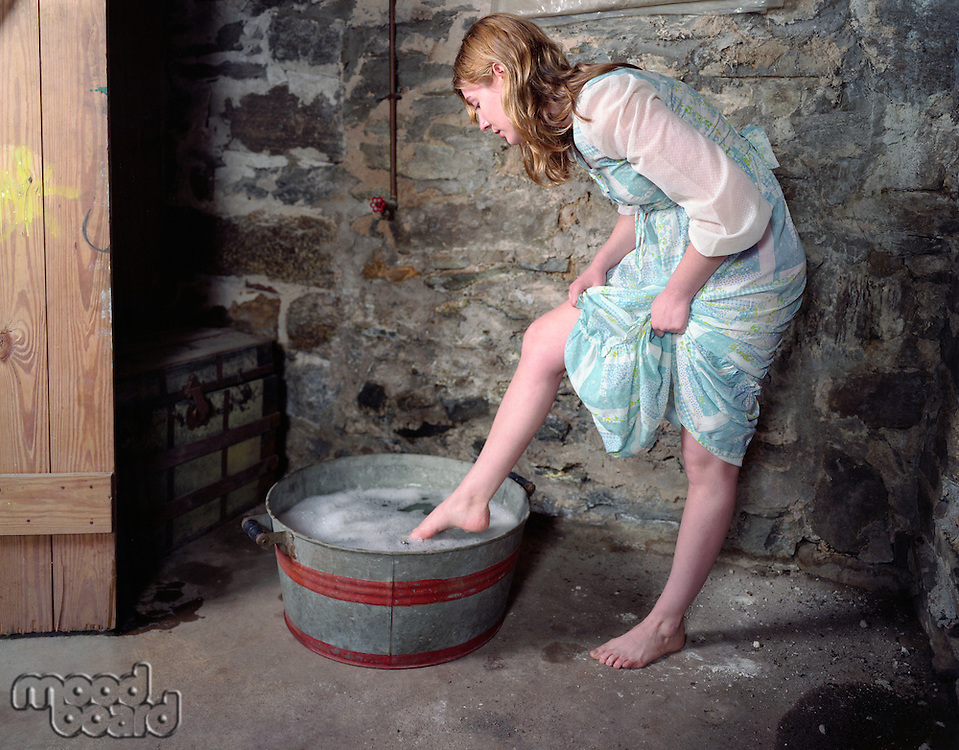 Woman Washing Her Feet