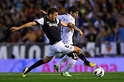 VALENCIA, SPAIN - APRIL 20: (L) Ignacio Camacho of Malaga CF  competes for the ball with (R) Ever Banega of Valencia CF during the Liga BBVA between Valencia CF and Malaga CF at the Mestalla stadium on April 20, 2013 in Valencia, Spain. (Photo by Aitor Alcalde Colomer).