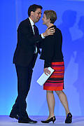 © Licensed to London News Pictures. 03/10/2012. Manchester, UK Leader of the Labour Party, Ed Miliband congratulates  Yvette Cooper, Shadow Home Secretary, after she delivered her speech on Day 4 at The Labour Party Conference at Manchester Central today 3rd october 2012. Photo credit : Stephen Simpson/LNP