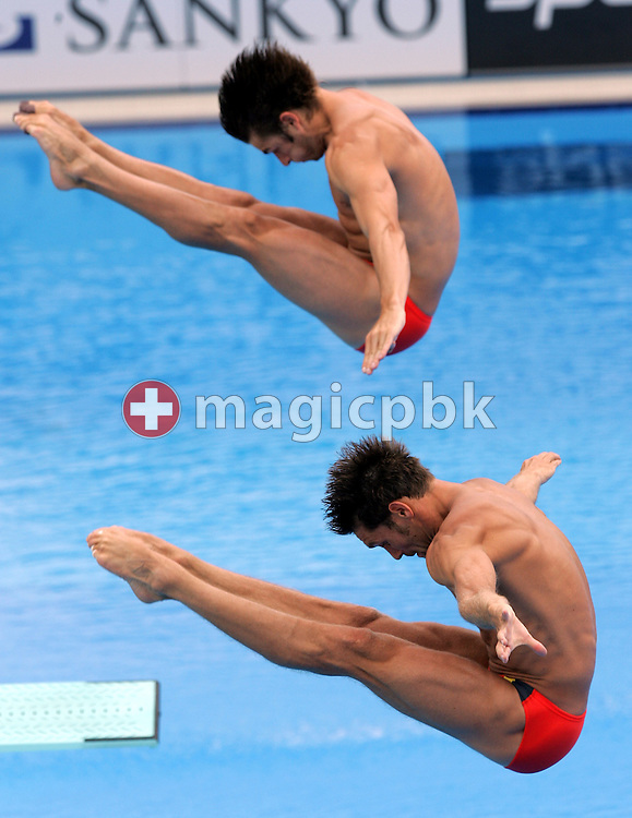 Germany's Tobias Schellenberg and Andreas Wels dive during the final round of the men's 3M synchro springboard competition at the FINA World Championships in Montreal, Quebec Sunday 17 July, 2005. China took the gold medal with a score of 384.42, Germany took silver with a score of 364.59 and USA took bronze with a score of 360.27. (Photo by Patrick B. Kraemer / MAGICPBK)