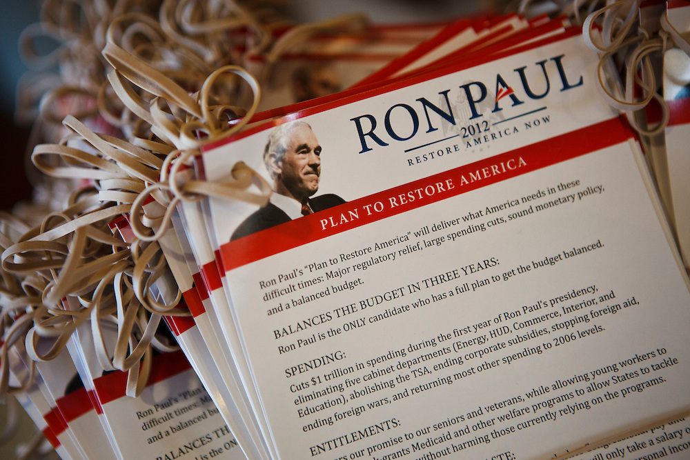 A stack of rubber band clad door hangers featuring Ron Paul's Plan To Restore America at the YMCA camp lodge used by Ron Paul supporters leading up to the Iowa Caucuses on Wednesday, December 28, 2011 in Boone, Iowa.