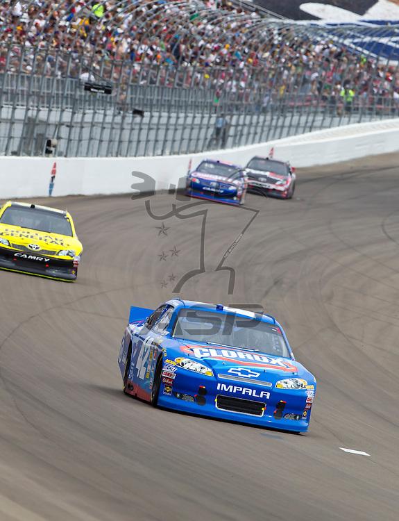 LAS VEGAS, NV - MAR 11, 2012:  Juan Pablo Montoya (42) brings his car through the turns during the Kobalt Tools 400 race at the Las Vegas Motor Speedway in Las Vegas, NV.