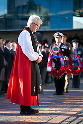 © Licensed to London News Pictures. 10/11/2013. Birmingham, UK. Pictured, the Bishop of Birmingham lays his wreath. Birmingham Remembrance Service, Millennium Square. Photo credit : Dave Warren/LNP