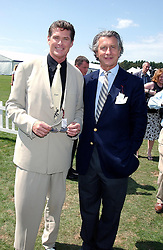 Left to right, actor DAVID HASSELHOFF and ARNAUD BAMBERGER MD of Cartier UK at the 2004 Cartier International polo day at Guards Polo Club, Windsor Great Park, Berkshire on 25th July 2004.