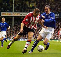 Photo. Jed Wee.<br /> Everton v Southampton, FA Barclaycard Premiership, Goodison Park, Liverpool. 19/10/03.<br /> Everton's David Weir (R) tries to keep tabs on Southampton's James Beattie.