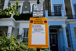 © Licensed to London News Pictures. 22/08/2019. London, UK. A parking suspended sign outside a residential property ahead of the 2019 Notting Hill Carnival in West London, which takes place this bank holiday weekend. Up to 1 million people are expected to attend the biggest street party in Europe. Photo credit: Dinendra Haria/LNP
