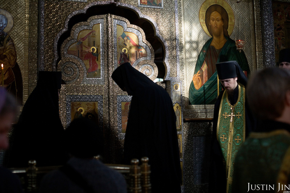 Priests conduct a service at the world-famous Srentenski Monastery Church in Moscow, Russia.