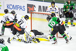 22.02.2015, Hala Tivoli, Ljubljana, SLO, EBEL, HDD Telemach Olimpija Ljubljana vs Dornbirner EC, 6. Qualification Round, in picture Tom Zanoski (HDD Telemach Olimpija, #10) vs Nathan Lawson (Dornbirner EC, #52) during the Erste Bank Icehockey League 6. Qualification Round between HDD Telemach Olimpija Ljubljana and Dornbirner EC at the Hala Tivoli, Ljubljana, Slovenia on 2015/02/22. Photo by Matic Klansek Velej / Sportida