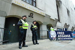 © Licensed to London News Pictures. 07/09/2020. LONDON, UK. Police outside the entrance of the Old Bailey as Wikileaks founder Julian Assange's extradition hearing, which is expected to last for the next three or four weeks, resumes after it was postponed due to the coronavirus pandemic lockdown.  Julian Assange is wanted in the US for allegedly conspiring with army intelligence analyst Chelsea Manning to expose military secrets in 2010.  Photo credit: Stephen Chung/LNP