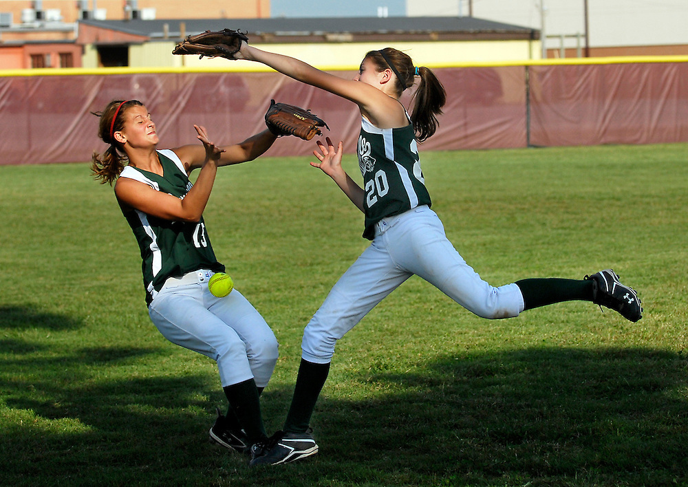 Perryville's Rebecca Gremaud, left, and Aleshia Reiss, right, collide as they go after a fly ball during the second inning of a game against Kelly on Wednesday, Sept. 22, 2010, at Thomas W. Kelly High School in Benton, Mo. Perryville won 7-4.