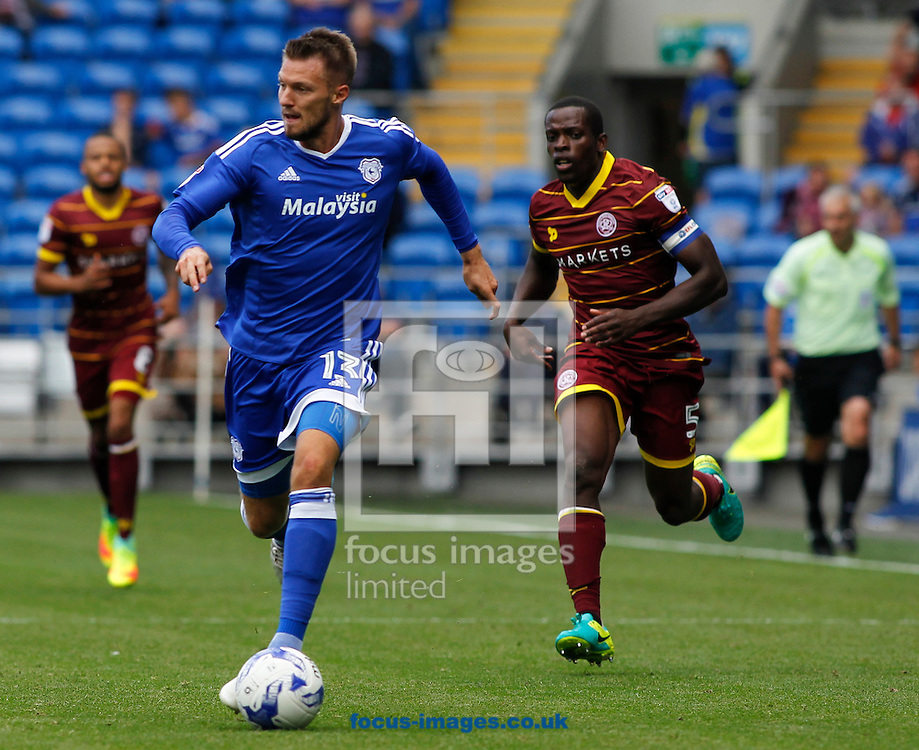 Anthony Pilkington of Cardiff City and Nedum Onuoha (R) of Queens Park Rangers during the Sky Bet Championship match at the Cardiff City Stadium, Cardiff<br /> Picture by Mike Griffiths/Focus Images Ltd +44 7766 223933<br /> 14/08/2016