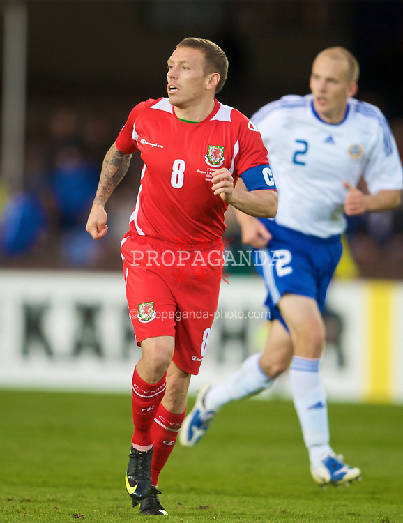 HELSINKI, FINLAND - Saturday, October 10, 2009: Wales' captain Craig Bellamy in action against Finland during the 2010 FIFA World Cup Qualifying Group 4 match at the Olympic Stadium. (Pic by David Rawcliffe/Propaganda)