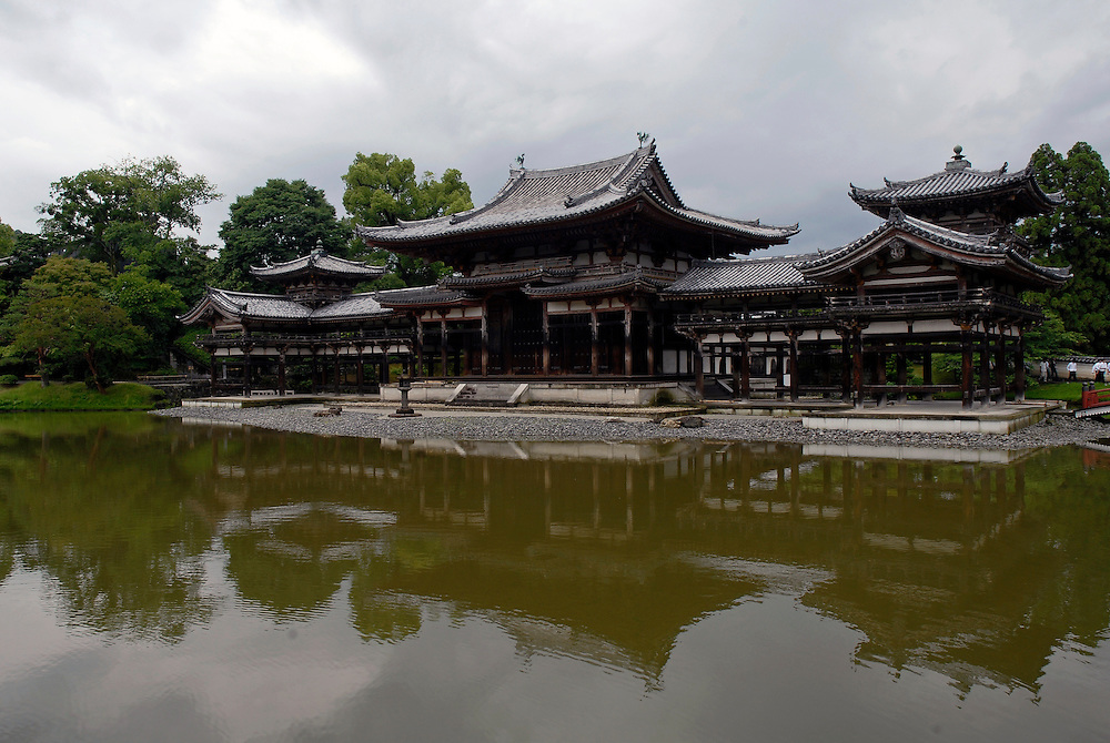 The Phoenix Hall..The Byodo-in  is a Buddhist temple in the city of Uji in Kyoto Prefecture. It is jointly a temple of the Jodo Shu (Pure Land) and Tendai sects..The most famous building in the temple is the Phoenix Hall or the Amida Hall, constructed in 1053.