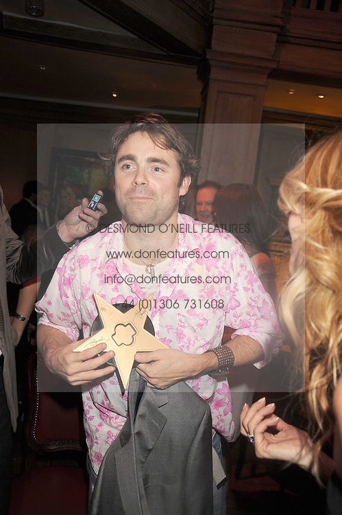 JAMES ARCHER at a party to celebrate the launch of Hollywood Domino - a brand new board game, held at Mosimann's 11b West Halkin Street, London on 7th November 2008.  The evening was in aid of Charlize Theron's Africa Outreach Project.