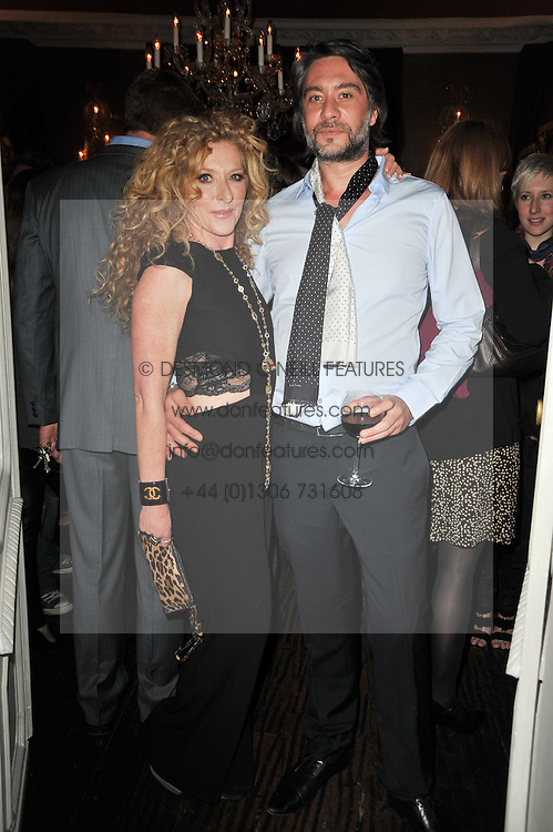 KELLY HOPPEN and ADAM MEIKLEJOHN at a party to celebrate the publication of her new book - Kelly Hoppen: Ideas, held at Beach Blanket Babylon, 45 Ledbury Road, London W11 on 4th April 2011.