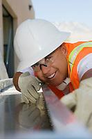 Workman Sighting Along a Beam