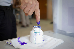 © Licensed to London News Pictures. 30/04/2014. Sulaimaniya, Iraq. An Iraqi-Kurdish male dips his finger in ink after voting at a school during the 2014 Iraqi parliamentary elections in Sulaimaniya, Iraqi-Kurdistan today (30/04/2014). <br /> <br /> The period leading up to the elections, the fourth held since the 2003 coalition forces invasion, has already seen polling stations in central Iraq hit by suicide bombers causing at least 27 deaths. Photo credit: Matt Cetti-Roberts/LNP