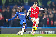 Arsenal midfielder Mesut Özil (10) takes the ball from Chelsea midfielder N'golo Kanté (7) during the Premier League match between Chelsea and Arsenal at Stamford Bridge, London, England on 21 January 2020.