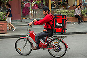 A scooter delivering Pizza Hut pizza Shanghai, China