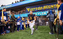Dec 3, 2016; Morgantown, WV, USA; West Virginia Mountaineers quarterback Skyler Howard (3) runs out during senior day ceremonies before their game against the Baylor Bears at Milan Puskar Stadium. Mandatory Credit: Ben Queen-USA TODAY Sports