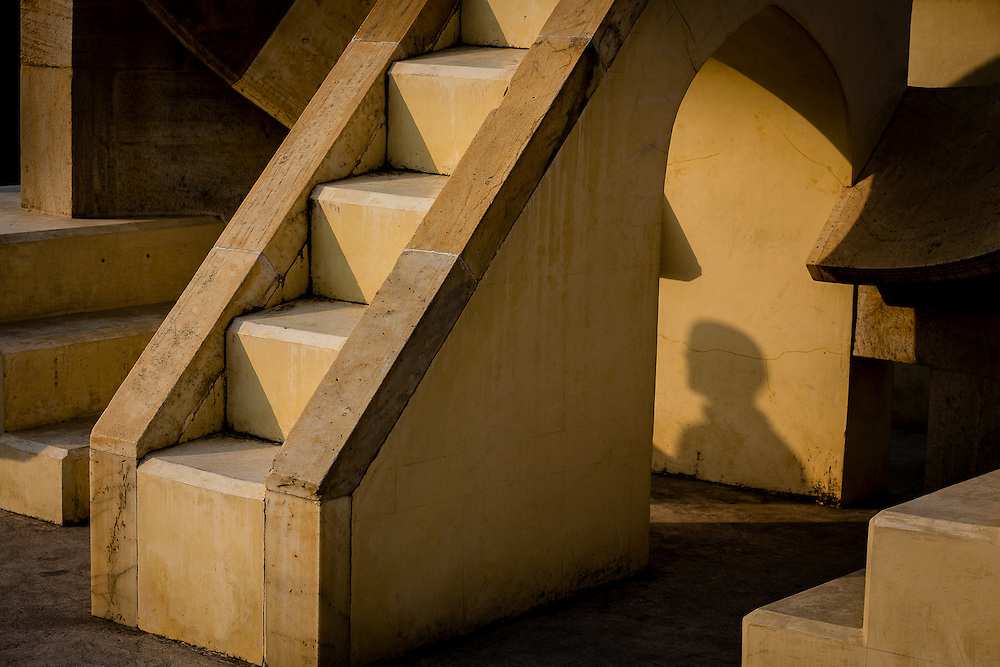 A shadow passes under the stairs of one of the 12 zodiac stairs in Jantar Matar. These small stariways were aligned so that each could be used to see the corresponding constellation of the zodiac.