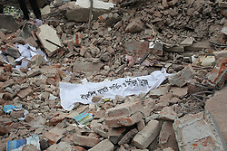 September 12, 2016 - Tongi,Dhaka, Bangladesh - A firefighter team found a body  under the rubbish  at rescue work the Tampaco factory  on 12 September, 2016 at tongi near Dhaka, Bangladesh. The rescuers have recovered four more bodies from the spot, as the death toll rises to 33. A huge fire has broken out at the five-storey factory building of Tampaco Foils Ltd after a boiler exploded around 6am on Saturday. Photo: Monirul Alam (Credit Image: © Monirul Alam via ZUMA Wire)