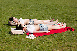 © Licensed to London News Pictures. 08/05/2016. LONDON, UK.  Two women sunbathe during hot sunny weather in Greenwich Park in south east London this morning. Today is forecast to be the hottest day of the year so far. Photo credit: Vickie Flores/LNP
