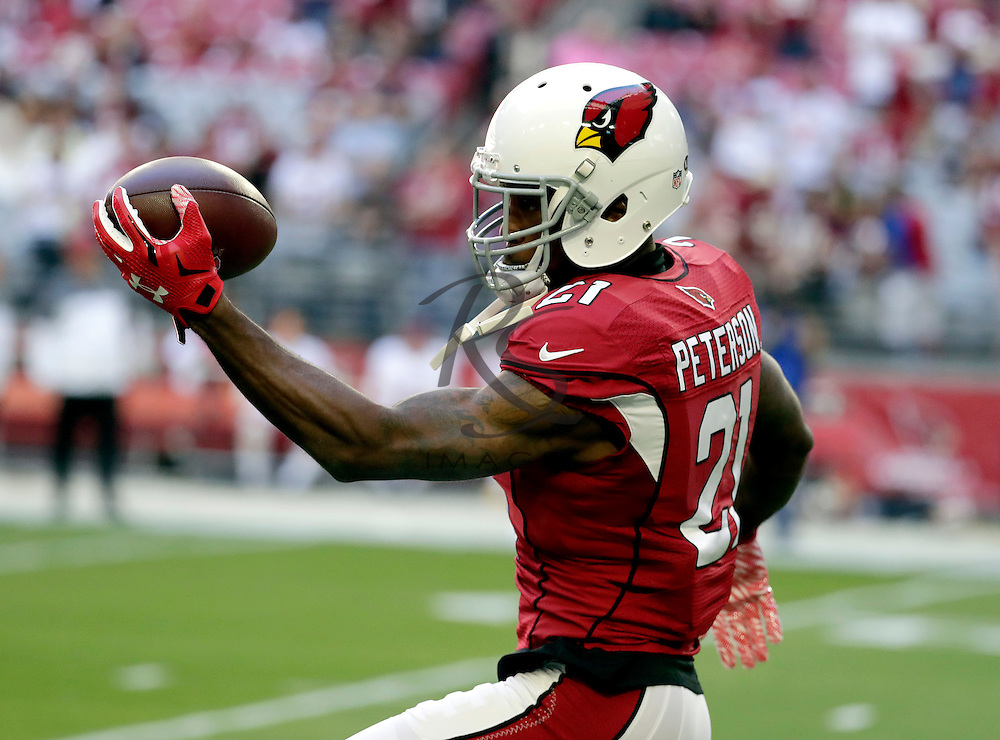 Arizona Cardinals cornerback Patrick Peterson (21) warms up prior to an NFL football game against the Washington Redskins, Sunday, Dec. 4, 2016, in Glendale, Ariz. (AP Photo/Rick Scuteri)