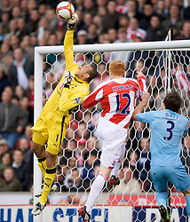 STOKE, ENGLAND - Sunday, October 19, 2008: Tottenham Hotspur's goalkeeper Heurelho Gomes makes a save under pressure from Stoke City's Dave Kitson during the Premiership match at the Britannia Stadium. (Photo by David Rawcliffe/Propaganda)
