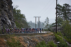 The peloton emerge from around a cliff face at Ladies Tour of Norway 2018 Stage 2, a 127.7 km road race from Fredrikstad to Sarpsborg, Norway on August 18, 2018. Photo by Sean Robinson/velofocus.com