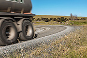water tanker on unsealed road New Zealand