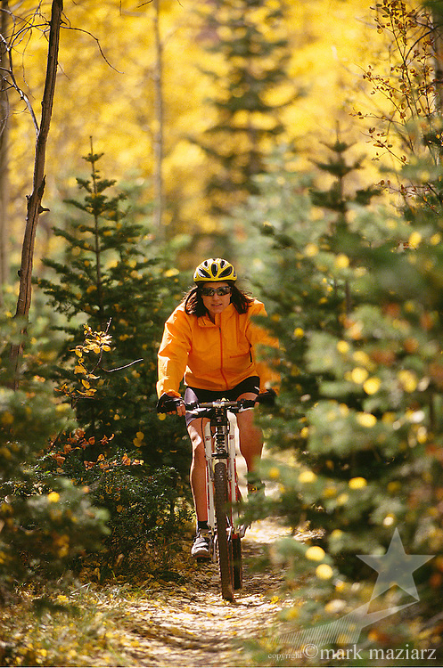 Holly riding through fall forest