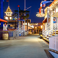 Newport Beach Balboa Fun Zone at night picture with businesses along the boardwalk. The Balboa Fune Zone is a popular attraction in Orange County Southern California. Photo is high resolution. Copyright ⓒ 2017 Paul Velgos with All Rights Reserved.