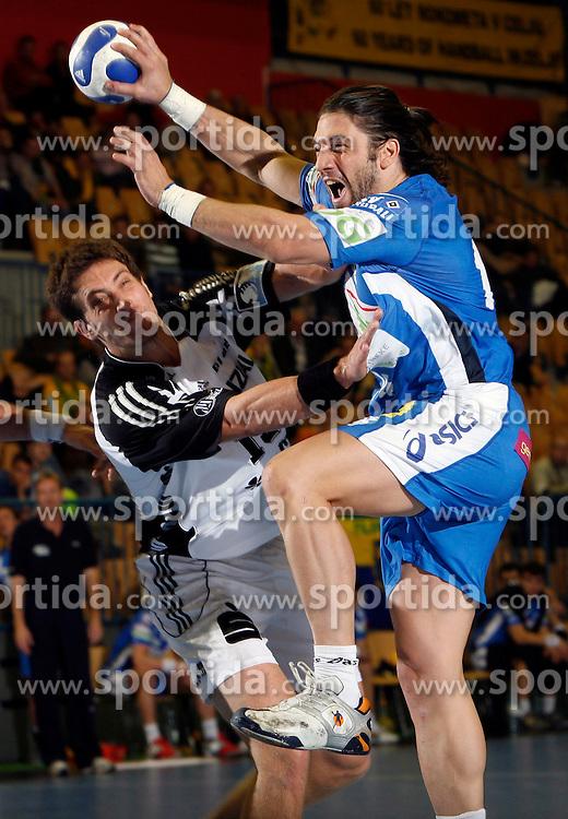 Markus Ahlm of Kiel trys to stop Bertrand Gille of Hamburg at handball game THW Kiel  - HSV Hamburg in the semifinal of EHF 2007 Men`s Champions Trophy, on October 20, 2007 in Zlatorog Hall, Celje, Slovenia.  Win of THW Kiel 31 : 30  (17:14).  (Photo by Vid Ponikvar / Sportal Images).