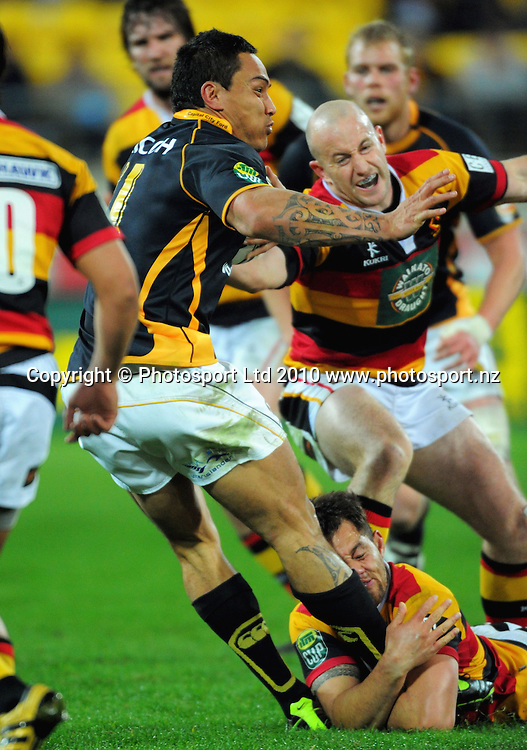 Brendan Leonard and Jack Lam try to bring down Wellington's Hosea Gear. ITM Cup rugby union - Wellington Lions v Waikato at Westpac Stadium, Wellington, New Zealand on Saturday, 21 August 2010. Photo: Dave Lintott/PHOTOSPORT