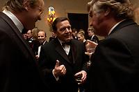 """20 NOV 2003, NEW YORK/USA:<br /> Gerhard Schroeder, SPD, Bundeskanzler, im Gespraech mit Spitzenvertretern der Wirtschaft, waehrend einem Empfang vor einer Festveranstaltung des American Institute for Contemporary German Studies anl. der Verleihung des """"Global Leadership Awards"""" Hotel Grand Hyatt at Grand Central<br /> IMAGE: 20031120-03-018<br /> KEYWORDS: Gerhard Schröder, U.S.A., Reise, Smoking<br /> Gespräch"""
