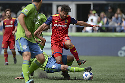 May 26, 2018 - Seattle, Washington, U.S - MLS Soccer 2018: Seattle midfielder JORDY DELEM (21) tackles RSL's DANILO ACOSTA (25) as Real Salt Lake visits the Seattle Sounders in a MLS match at Century Link Field in Seattle, WA. RSL won the match 1-0. (Credit Image: © Jeff Halstead via ZUMA Wire)