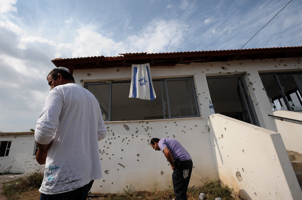 Beer Tuvia Regional Council, Israel - November 17, 2012: Israelis are inspecting the damage caused to a house that was hit by a rocket fired from Gaza Strip at the fourth day of Operation Pillar of Defense. Photo by Gili Yaari  - Israel Photojournalist