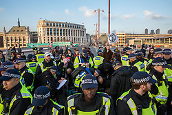 London, UK. 17th November, 2018. Police officers arrest environmental campaigners from Extinction Rebellion who had blocked Blackfriars Bridge, one of five bridges blocked in central London, as part of a Rebellion Day event to highlight 'criminal inaction in the face of climate change catastrophe and ecological collapse' by the UK Government as part of a programme of civil disobedience during which scores of campaigners have been arrested.